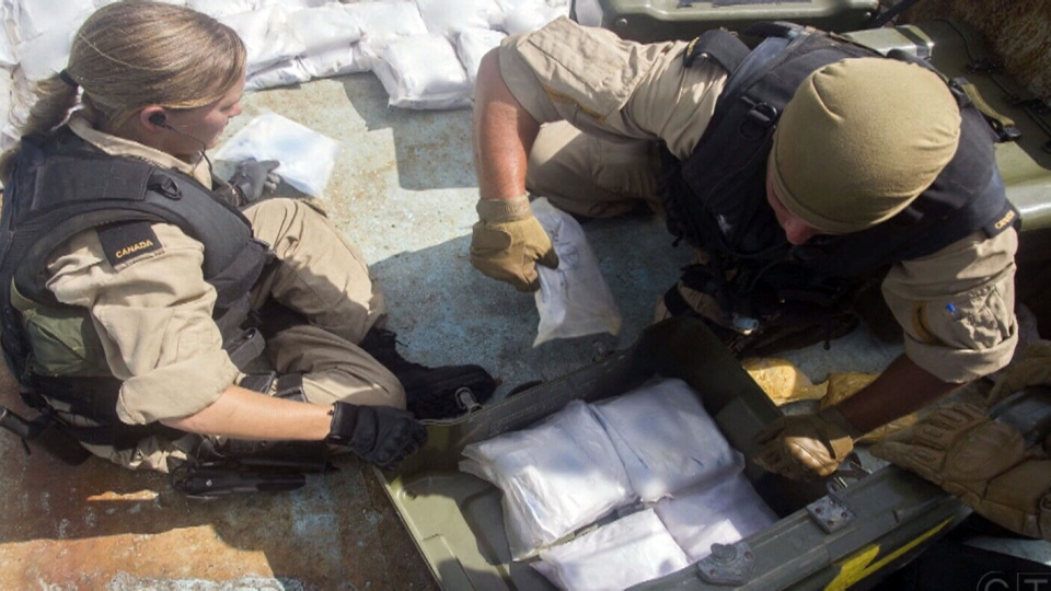 A Canadian warship seized 154 bags of heroin from a ship on Arabian Sea.