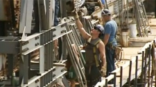 Workers toiling on the Mercier Bridge Friday had their hands full. (June 17, 2011)