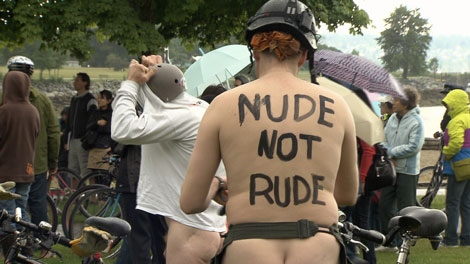 Nude bicyclists braved the rain in Vancouver for the annual Naked Bike Ride protesting oil dependency. June 18, 2011. (CTV)