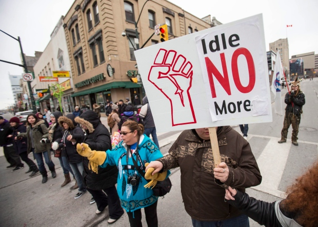 Demonstrators with the Idle No More movement block an intersection in downtown London, Ont. Thursday, March 21, 2013. (The Canadian Press / Geoff Robins)