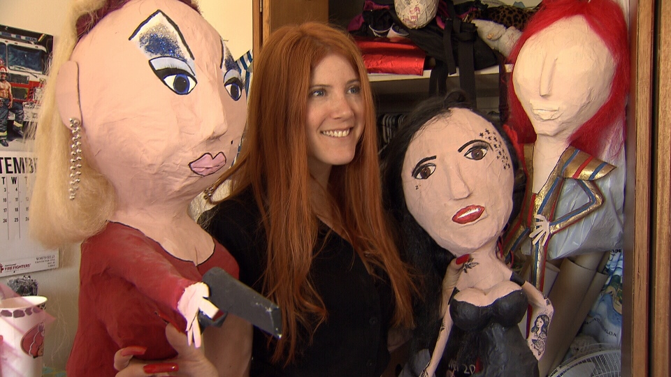 Meaghan Kennedy shows off her celebrity pinatas, Kat Von D and Divine.