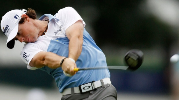 Rory McIlroy, of Northern Ireland, drives from the ninth tee during the third round of the U.S. Open Championship golf tournament in Bethesda, Md., Saturday, June 18, 2011. (AP / Matt Slocum)