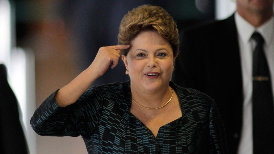 Brazil's President Dilma Rousseff gestures as she answers a journalist's question at the Planalto presidential palace in Brasilia, Brazil, Monday, Sept. 30, 2013. (AP / Eraldo Peres)