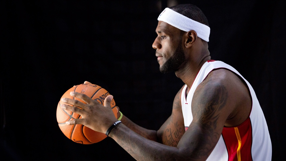 Miami Heat's LeBron James poses for photos during the team's NBA basketball media day in Miami, Monday, Sept. 30, 2013. (AP / J Pat Carter)