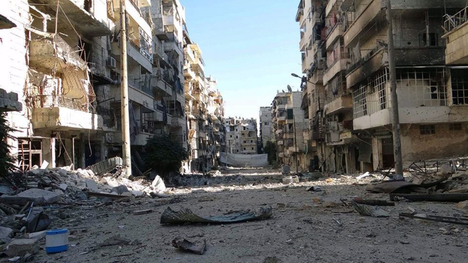 Damage to buildings due to heavy fighting between government forces and Free Syrian Army fighters can be seen in Aleppo, Syria, Monday, Oct. 7, 2013. (Aleppo Media Center AMC)