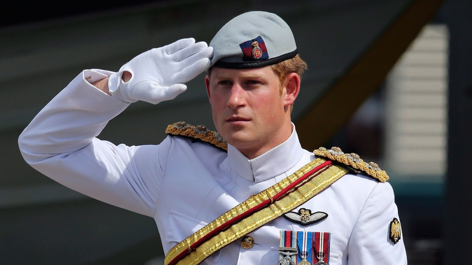 Prince Harry receives a royal salute from the honor guard at Garden Island Naval base in Sydney, Australia, Saturday, Oct. 5, 2013. (AP / Rob Griffith)
