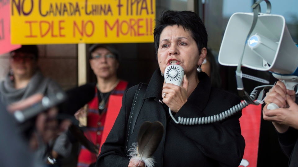 Claudette Commanda speaks during an Idle No More rally in front of the Museum of Civilization in Gatineau, Que. as part of a worldwide mass day of action in reaction to the 250th anniversary of the British Royal Proclamation on Monday, Oct. 7, 2013. (Justin Tang / THE CANADIAN PRESS)