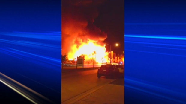 A huge fire broke out on Tuesday morning in the southeast Calgary community of Auburn Bay. 100 people were forced out of their homes as a result. (MyNews/Mike Cameron)