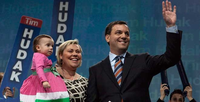 Leader of the Progressive Conservative Party of Ontario Tim Hudak, right, waves to the crowd on stage with his wife Debbie Hutton and daughter Miller after delivering the keynote address at the Annual General Meeting of the Progressive Conservative Party in Ottawa on Saturday, March 6, 2010. (Pawel Dwulit / THE CANADIAN PRESS)