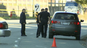 Vancouver police investigate a drive-by shooting on Southeast Marine Drive on Tuesday, Oct. 8, 2013. (CTV)