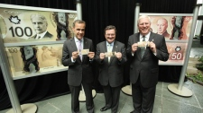 Mark Carney, Governor of the Bank of Canada, left, Finance Minister Jim Flaherty and RCMP Commissioner William Elliott unveil the new polymer bank note series at the Bank of Canada's head office in Ottawa, Monday, June 20, 2011. (Bank of Canada / The Canadian Press Images)