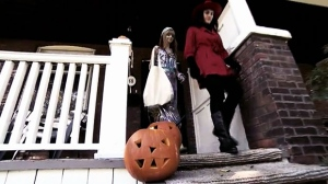 Kids in costume trick-or-treat on Halloween