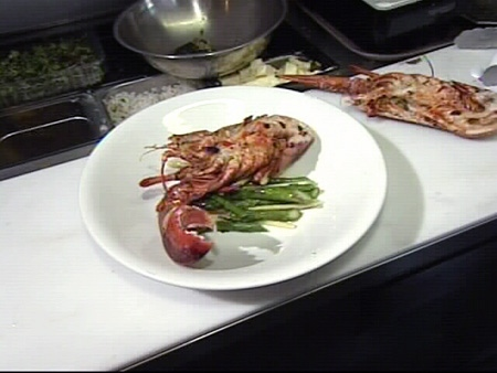 Chef Derek Benitz of the Benitz Bistro prepares BBQ garlic basted lobster salad, Tuesday, June 10, 2008.