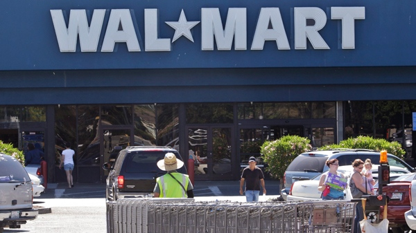 A Wal-Mart worker pull carts at a Wal-Mart store in Pittsburg Calif., Monday, June 20, 2011. (AP / Paul Sakuma)