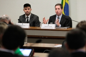 American journalist Glenn Greenwald, right, speaks to a congressional committee investigating reports based on documents, leaked by former National Security Agency contractor Edward Snowden, showing that Brazil was targeted by spy agencies from the U.S., Britain and Canada, at Congress in Brasilia, Brazil, Wednesday, Oct. 9, 2013. (AP / Eraldo Peres)