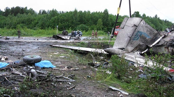 In this photo provided by Russia Emergency Situations Ministry press service, wreckage of Tu-134 plane, belonging to the RusAir airline, is seen on a highway near the city of Petrozavodsk Tuesday, June 21, 2011. (Ministry of Emergency Situations press service)