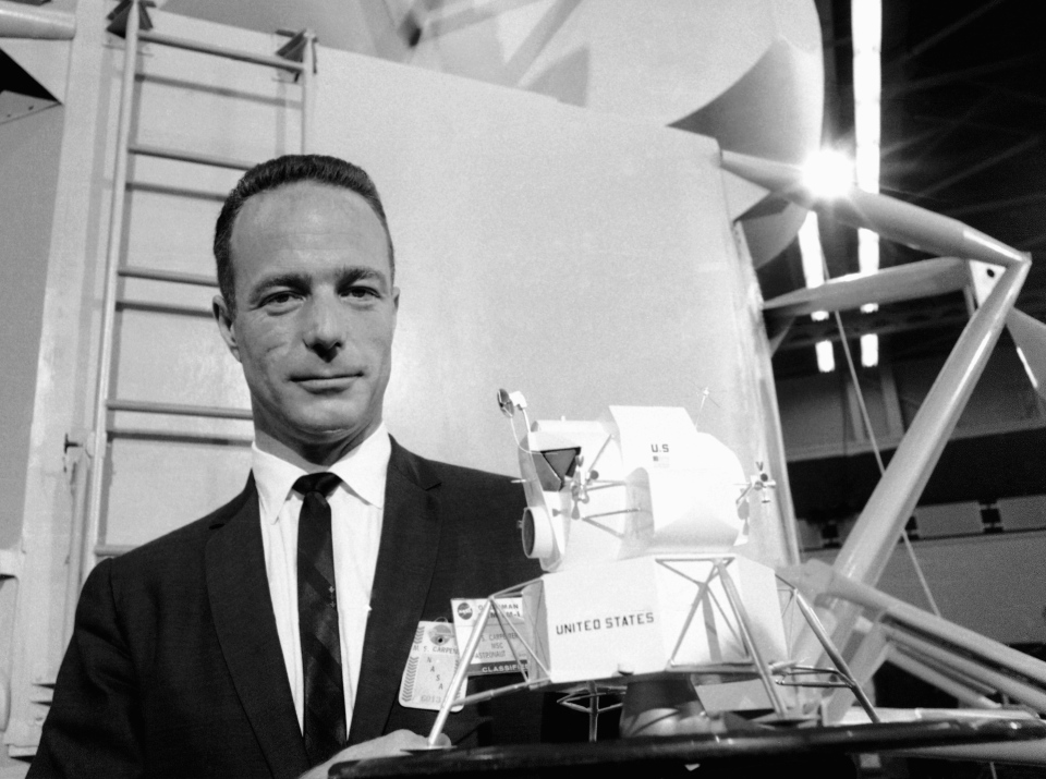 Astronaut Scott Carpenter poses with model of the Lunar Excursion Module (LEM) at Grumman Aircraft engineering Corp. plant in Bethpage, N.Y., March 26, 1967. (AP / Camerano)