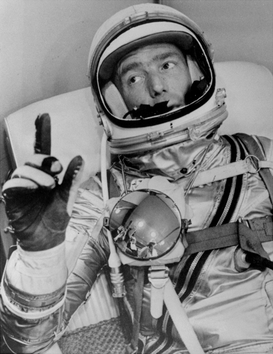 Astronaut Scott Carpenter gestures with one hand after donning his space suit in Hangar S prior to being shot into orbit at Cape Canaveral, Fla., May 24, 1962. (NASA)
