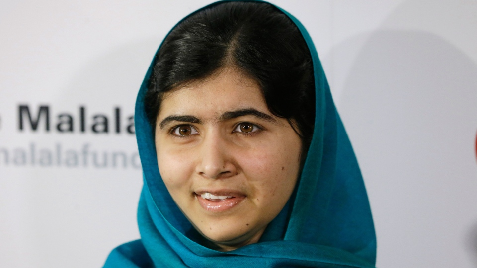 Malala Yousafzai poses for photographs in New York on Thursday, Oct. 10, 2013. (AP / Frank Franklin II)