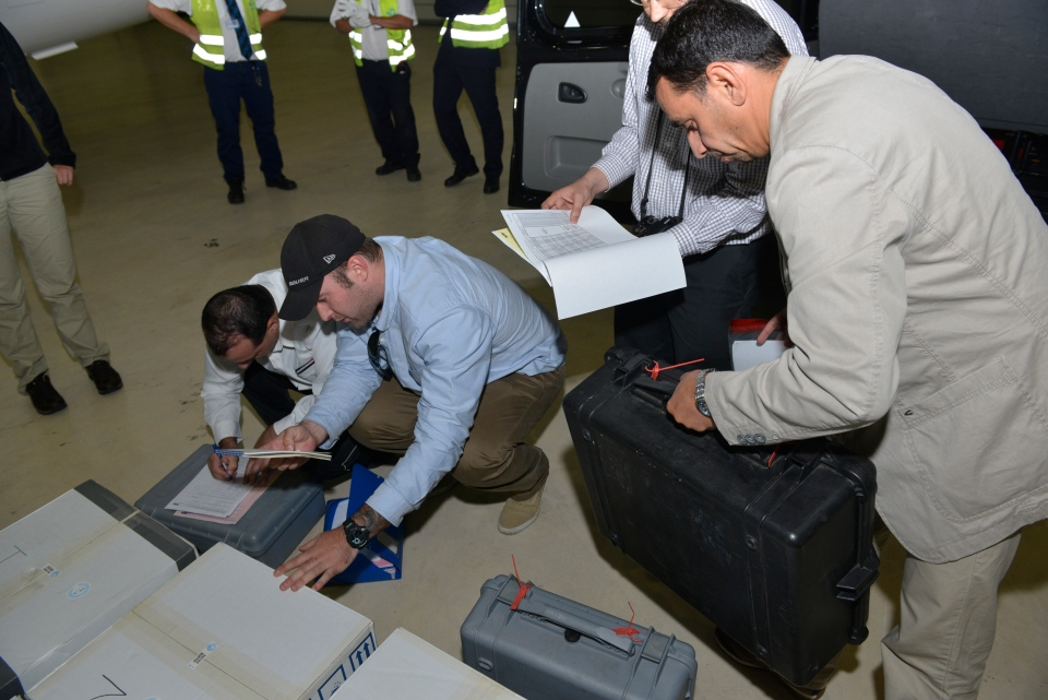 Samples brought back by a UN chemical weapons inspection team are checked in upon their arrival at The Hague, Netherlands, Saturday, Aug. 31, 2013. (OPCW / Henry Arvidsson)