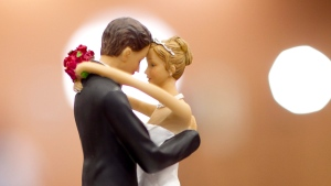 A figurine of a bride and a groom sits atop a wedding cake in Raleigh, N.C., on Tuesday, May 8, 2012. (The News and Observer / Robert Willett)