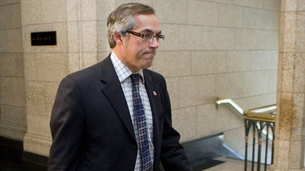 Tony Clement, President of the Treasury Board and Minister for the Federal Economic Development Initiative for Northern Ontario, makes his way to question period in the House of Commons on Parliament Hill in Ottawa, Tuesday, June 21, 2011. (Adrian Wyld / THE CANADIAN PRESS)