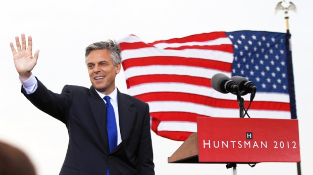 Former Utah Gov. Jon Huntsman waves as he announces his bid for the ...