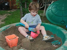 Two-year-old Shane plays in a sandbox in Oakville, Ont. (THE CANADIAN PRESS/ Richard Buchan)