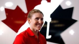 Canadian National Women's hockey player Hayley Wickenheiser, from Shaunavon, Sask., speaks to a reporter a news conference in Calgary, Alta., May 27, 2013. (The Canadian Press/Jeff McIntosh)