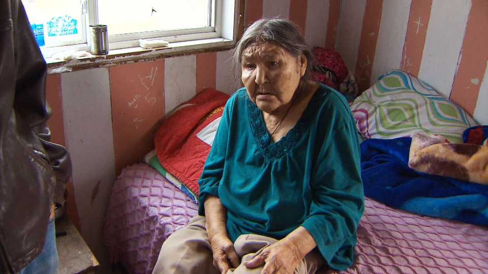 A UN investigator visited a remote reserve where this elderly woman who lost her leg lives without running water in northwest Manitoba, Saturday, Oct. 12, 2013.