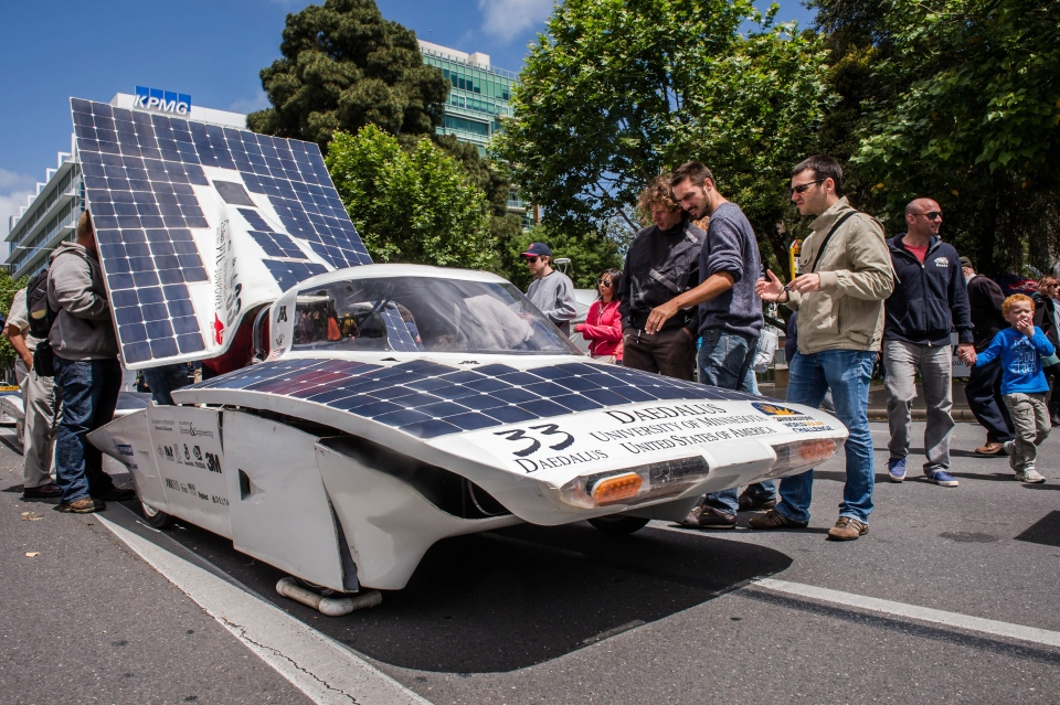 People look at the Daedalus of the University of Minnesota during the 2013 World Solar Challenge closing parade in Adelaide, Australia on Sunday, Oct. 13, 2013. (AP Photo/Geert Vanden Wijngaert)