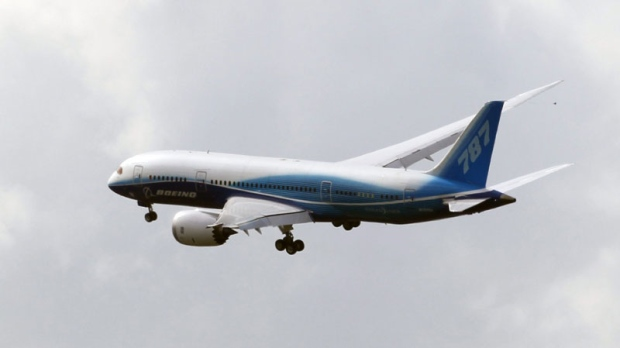 A Boeing 787 Dreamliner prepares to land at Le Bourget airport, during the Dreamliner's first presentation at the 49th Paris Air Show, Le Bourget, east of Paris, Tuesday, June 21, 2011. (AP Photo/Francois Mori)