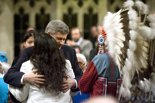 Prime Minister Stephen Harper hugs Beverley Jacobs, Head of the Native Womens Association of Canada, after she responded to the apology in the House of Commons on Parliament Hill in Ottawa, on Wednesday, June 11, 2008. (Tom Hanson  / THE CANADIAN PRESS)
