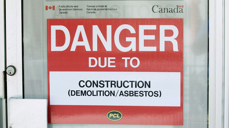 A danger sign is seen outside a construction zone in Ottawa, Monday June 20, 2011. Activists are accusing Canada of hiding behind other exporters of chrysotile asbestos at a major international conference in Geneva. (THE CANADIAN PRESS/Adrian Wyld)