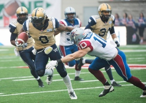 Vegan Montreal Alouettes linebacker Marc-Olivier Brouillette makes a tackle in his playing days. The former all-star is a spokesperson for the Montreal Vegan Festival. THE CANADIAN PRESS/Graham Hughes