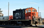 A CN locomotive makes its way through the CN Taschereau yard in Montreal. (The Canadian Press/Graham Hughes)