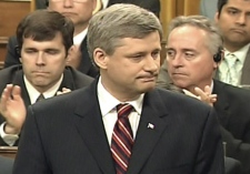 Prime Minister Stephen Harper pauses during his apology to survivors of residential school abuse in the House of Commons on Wednesday, June 11, 2008.