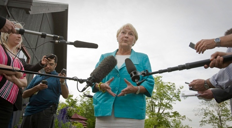 Parti Quebecois leader Pauline Marois gestures as she speak during a press conference at Dushesnay Conservation centre in Sainte-Catherine-de-la-Jacques-Cartier, just north of Quebec city, Wednesday June 22, 2011. Marois says she asked her elected members at an emergency gathering whether they agree with the party program, whether they will remain with the PQ, and whether they will continue to support her leadership.THE CANADIAN PRESS/Francis Vachon