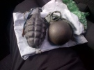 Two decorative, inert hand grenades that prompted the evacuation of the Federal Building in Sarnia, Ont. are seen on Tuesday, Oct. 15, 2013. (Const. Heather Emmons / Sarnia Police Service)