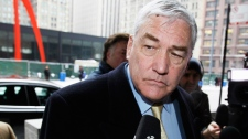 In this Jan. 13, 2011 file photo, former media mogul Conrad Black arrives at the federal building in Chicago. (AP / Charles Rex Arobasgt)