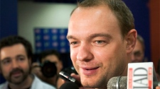 Montreal Canadiens defenceman Andrei Markov speaks to reporters as the team reports for medicals Friday Sept. 17, 2010, in Brossard, Quebec.THE CANADIAN PRESS/Ryan Remiorz