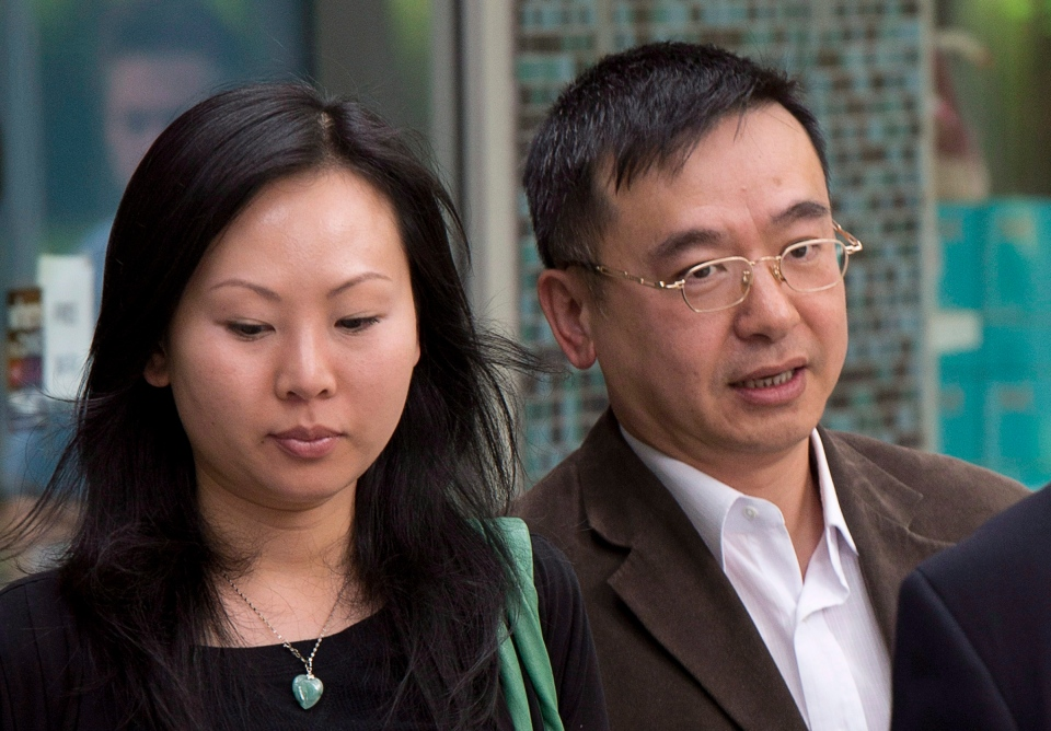 Franco Yui Kwan Orr and his partner Oi Ling Nicole Huen arrive at the B.C. Supreme court in downtown Vancouver, B.C. Thursday, May 30, 2013. (Jonathan Hayward / THE CANADIAN PRESS)