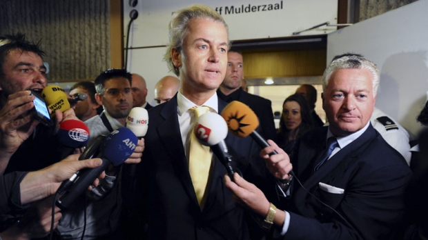 Right-wing politician Geert Wilders and his lawyer Bram Moszkowicz, right, as Wilders gives a brief statement after A Dutch court acquitted him of hate speech and discrimination in Amsterdam, Thursday June 23, 2011. (AP Photo/Evert Elzinga)