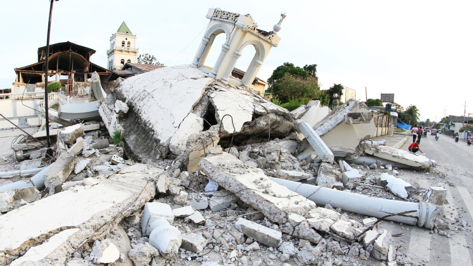 This Tuesday, Oct. 15, 2013 photo shows a collapsed building in Bohol after a 7.2-magnitude earthquake struck the central Philippine island of Bohol in the morning. (AP / Str)
