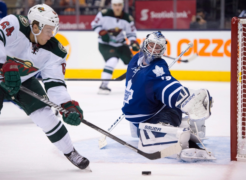 Toronto Maple Leafs goaltender James Reimer makes a save on Minnesota Wild centre Mikael Granlund (64) during the third period in Toronto on Tuesday, Oct. 15, 2013. (Frank Gunn / THE CANADIAN PRESS)