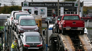 New vehicles are loaded on transport trucks at Autoport Limited in Eastern Passage, N.S. near Halifax on Tuesday, Oct. 15, 2013. (THE CANADIAN PRESS / Andrew Vaughan)
