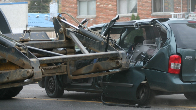 Police are investigating a collision that took place Tuesday, October 15 on 109 St. near 107 Ave., that involved a front-end loader and a minivan, and injured a woman and a child.