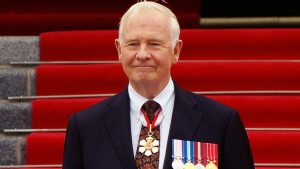 Gov. Gen. David Johnston arrives at Parliament Hill to read the speech from the throne in the Senate chamber in Ottawa, Ont., on Wednesday Oct. 16, 2013.