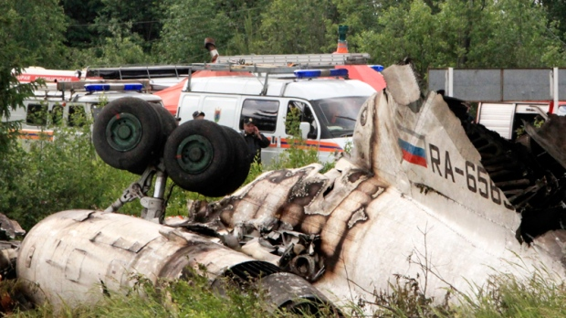 Emergency Ministry cars seen near a wreckage of Tu-134 plane, belonging to the RusAir airline, near the city of Petrozavodsk Tuesday, June 21, 2011. (AP / Timur Khanov, Komsomolskaya Pravda)