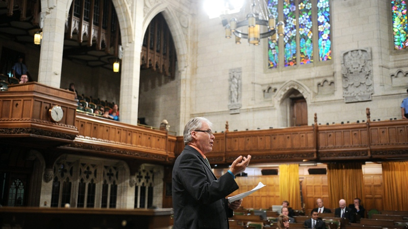 New Democratic Party MP Bruce Hyer speaks in the House of Commons as his party continues their filibuster on the Government back-to-work legislation on Parliament Hill in Ottawa on Friday, June 24, 2011. (Sean Kilpatrick / THE CANADIAN PRESS)